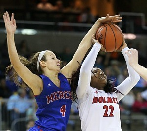Mercer County's Seygan Robins puts the defense on Holmes'  Jaynice Stovall. (Photo by Jim Osborn)
