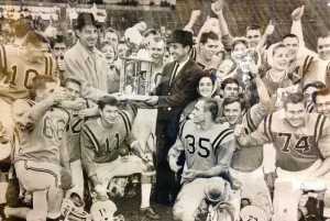 Lynch East Main's 1960 state champs receive their title trophy.